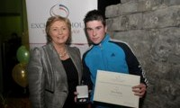 John Reilly receives his Award from Minister Fitzgerald