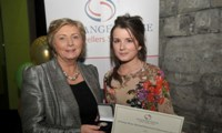 Susanne Stokes receives her Award from Minister Fitzgerald