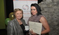 Cassie Stokes receives her Award from Minister Fitzgerald