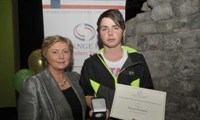 Daniel Donnelly receives his Award from Minister Fitzgerald
