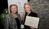 Ashley Power receives her Award from Minister Fitzgerald
