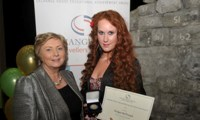 Bridget McDonagh receives her Award from Minister Fitzgerald