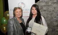 Donna Stokes receives her Award from Minister Fitzgerald