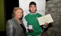 Hughie Maughan receives his Award from Minister Fitzgerald