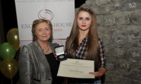 Eileen McDonagh receives her Award from Minister Fitzgerald