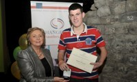 Martin O'Donnell receives his Award from Minister Fitzgerald