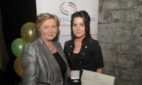 Breda Stokes receives her Award from Minister Fitzgerald