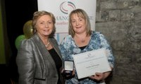 Sandra McDonagh receives her Award from Minister Fitzgerald