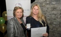 Bridget McInerney receives her Award from Minister Fitzgerald