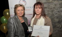 Nancy Power receives her Award from Minister Fitzgerald