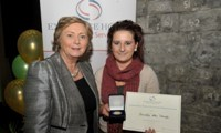 Priscilla McDonagh receives her Award from Minister Fitzgerald