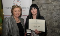 Cathleen Joyce receives her Award from Minister Fitzgerald