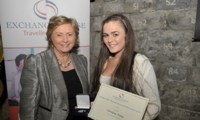Christine Stokes receives her Award from Minister Fitzgerald