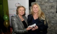 Minister Fitzgerald presents Bridget McInerney with a raffle prize of an MP3 player