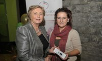 Minister Fitzgerald presents Priscilla McDonagh with a raffle prize of an MP3 player