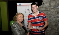 Minister Fitzgerald presents Martin O'Donnell with a raffle prize of an MP3 player