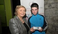Minister Fitzgerald presents John Reilly with a raffle prize of an MP3 player