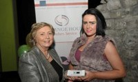 Minister Fitzgerald presents Cassie Stokes with a raffle prize of an MP3 player