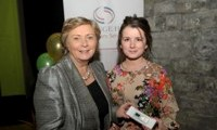 Minister Fitzgerald presents Susanne Stokes with a raffle prize of an MP3 player