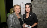 Minister Fitzgerald presents Breda Stokes with a raffle prize of an MP3 player