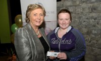 Minister Fitzgerald presents Shantelle Donegan with a raffle prize of an MP3 player