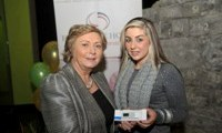 Minister Fitzgerald presents Natalie McDonagh with a raffle prize of an MP3 player