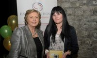 Minister Fitzgerald presents Cathleen Joyce with a raffle prize of a digital camera