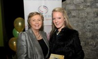 Minister Fitzgerald presents Ashley Power with a raffle prize of a digital camera