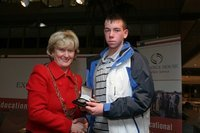 Christopher Lynch receives his award from Dublin Lord Mayor Eibhlin Byrne